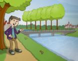 jongen langs het kanaal